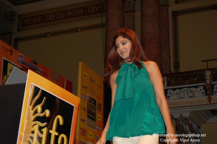 Shilpa Shetty steps toward the podium