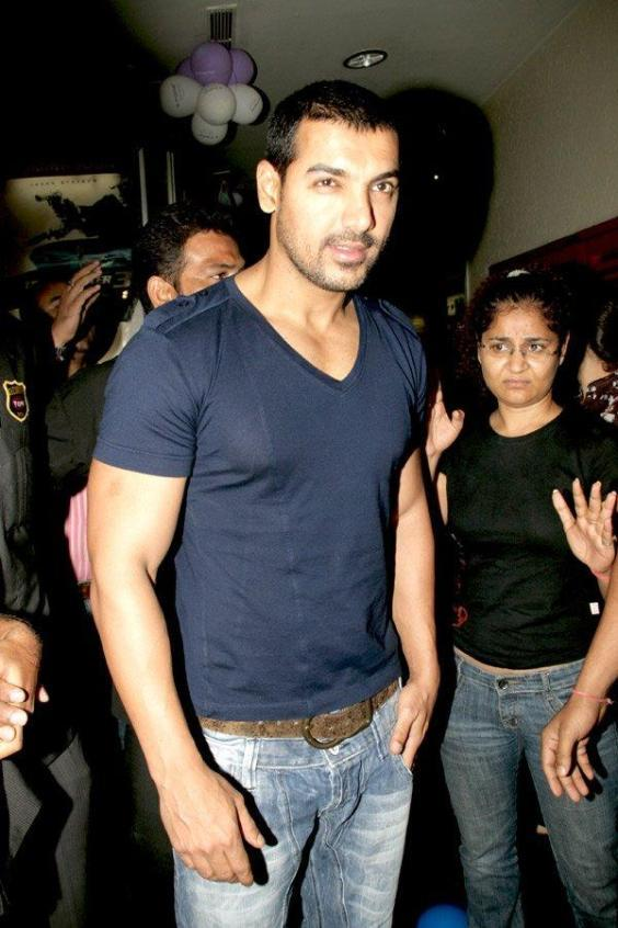 John Abraham Hot Pose With Blue T Shirt and Tight Jeans