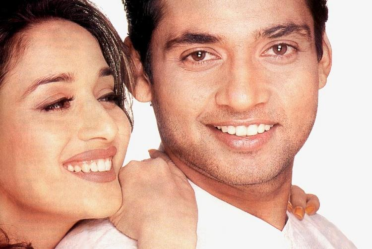 Madhuri Dixit and Ajay Jadeja smilling face