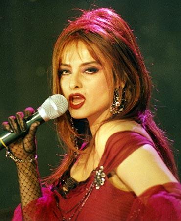 Rekha as singer pose