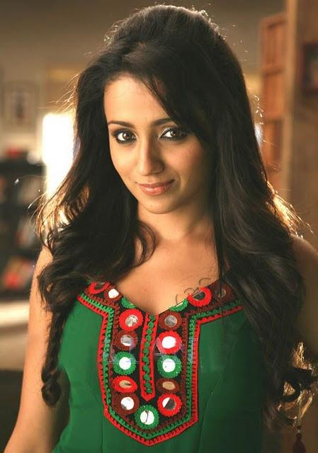 Trisha in green color dress posing hot in Mankatha