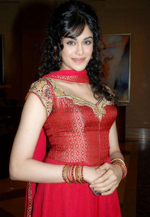 Adah Sharma posing sexy smile in red dress