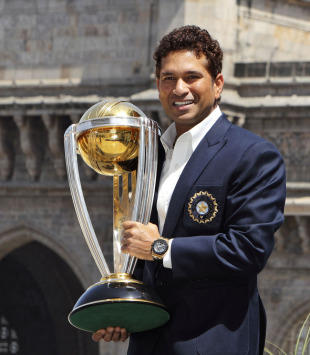 ICC world cup sachin tendulkar stands with world cup picture