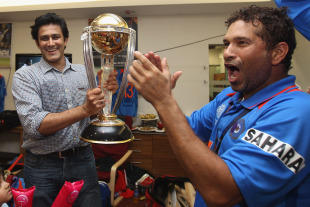 cricket world cup  anil Kumble stands with cup and Sachin Tendulkar is clap