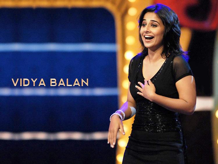Vidya Balan with open smile pics