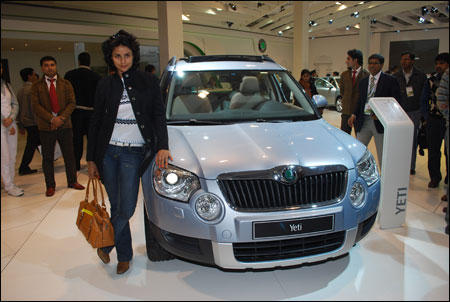 Gul Panag poses with car model Skoda Yeti
