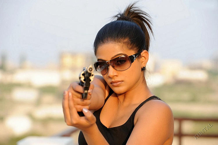 Priyamani looking very hot with gun