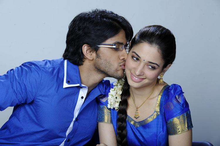Love telugu movie Naga chaitanya Tamanna kiss stills