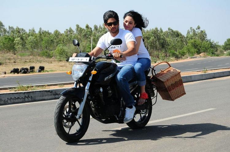Love telugu movie Naga chaitanya and Tamanna bike pictures