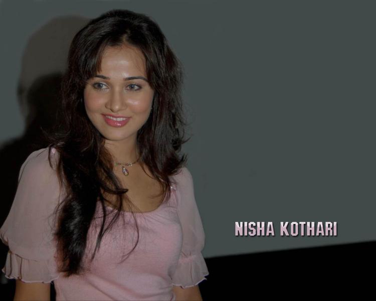 Nisha Kothari  sexy smile pics