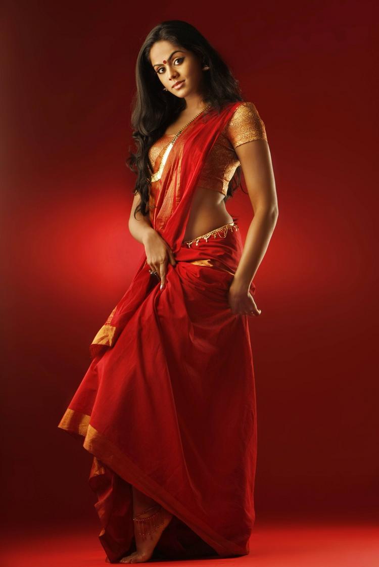 karthika Nair latest hot stills in red color dress