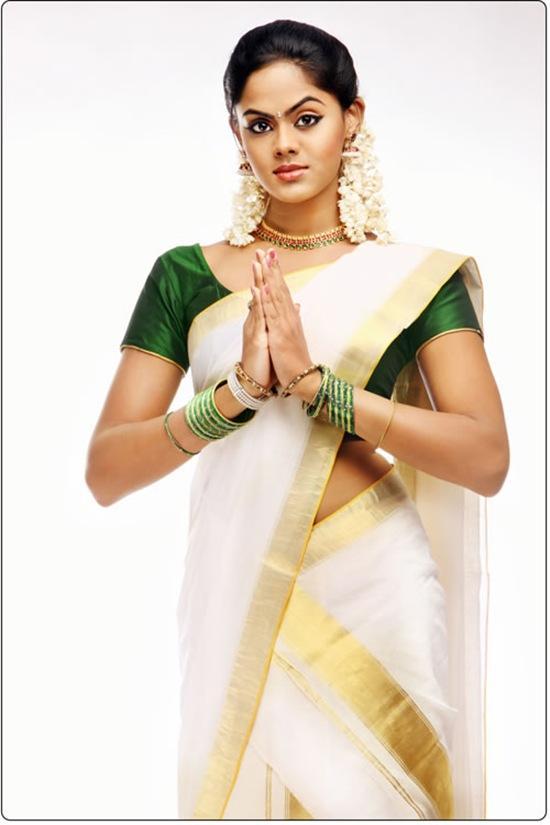 karthika nair saree stills latest photoshoot