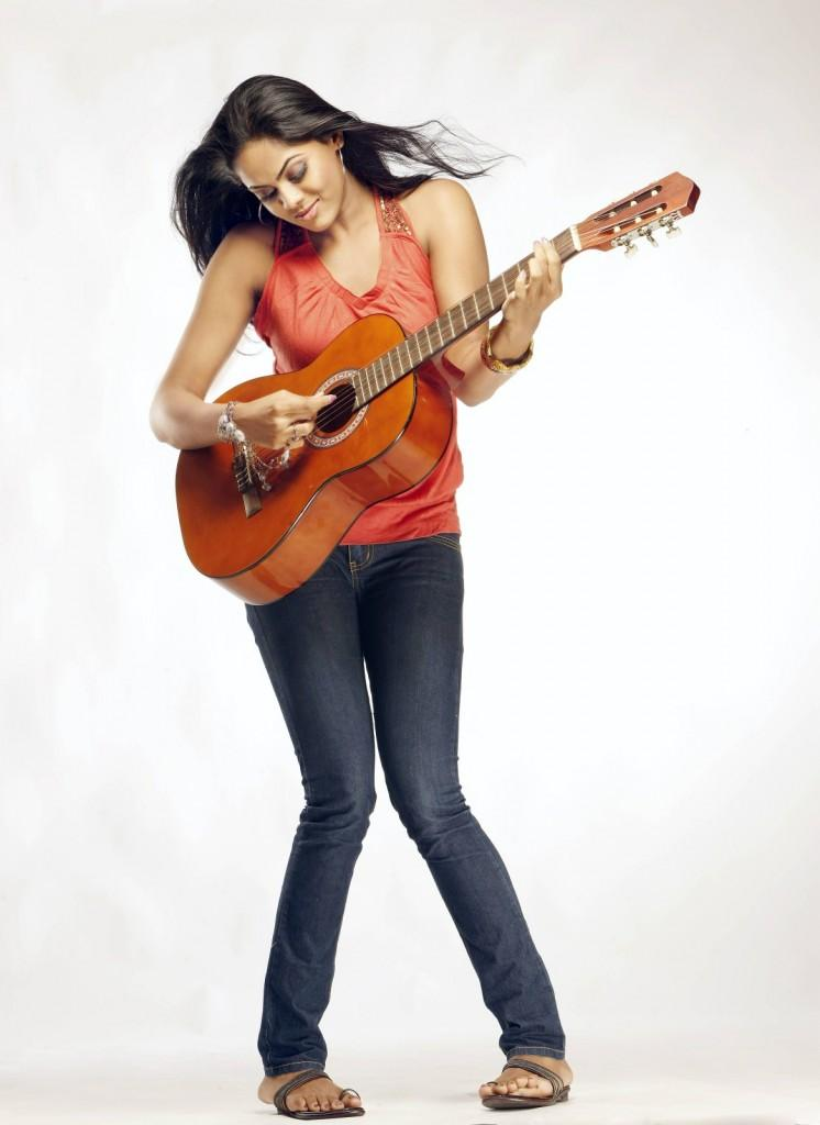 karthika Nair latest hot stills in photo shoot red color dress