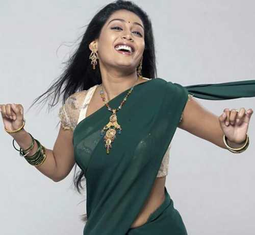 Nayanthara cute stills in green color saree