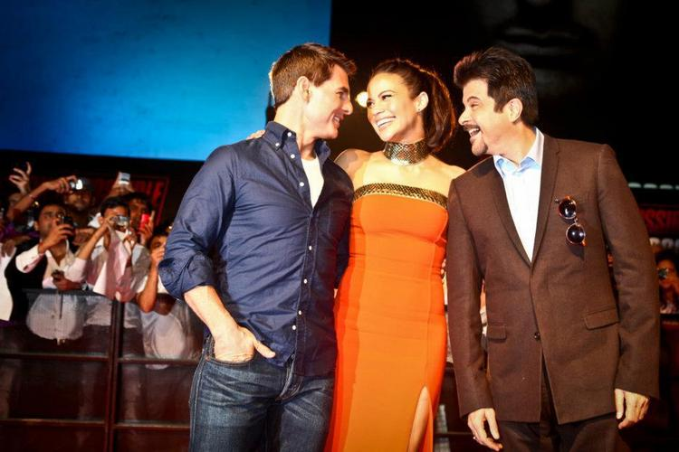 Tom Cruise sharing a light moment with Anil Kapoor