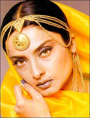 Rekha in yellow color hot saree
