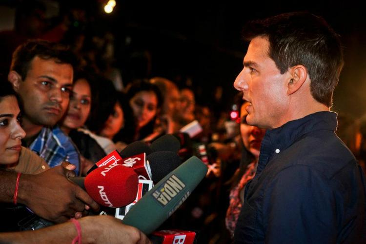Tom Cruise interacting with news channel persons