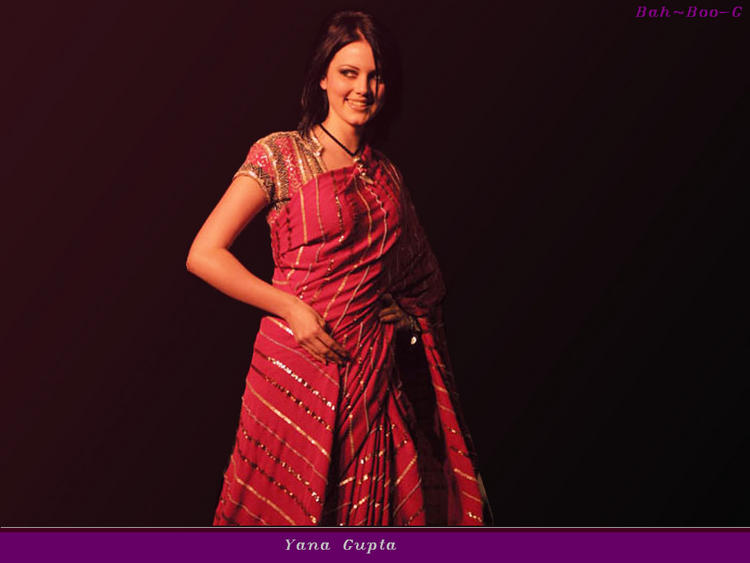 Yana Gupta in red saree cute stills