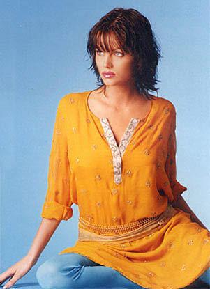 Yana Gupta hot pose in yellow color dress