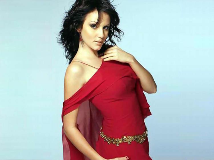 Yana Gupta sexy pose in red dress