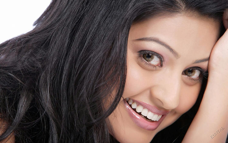Sneha sweet smile still