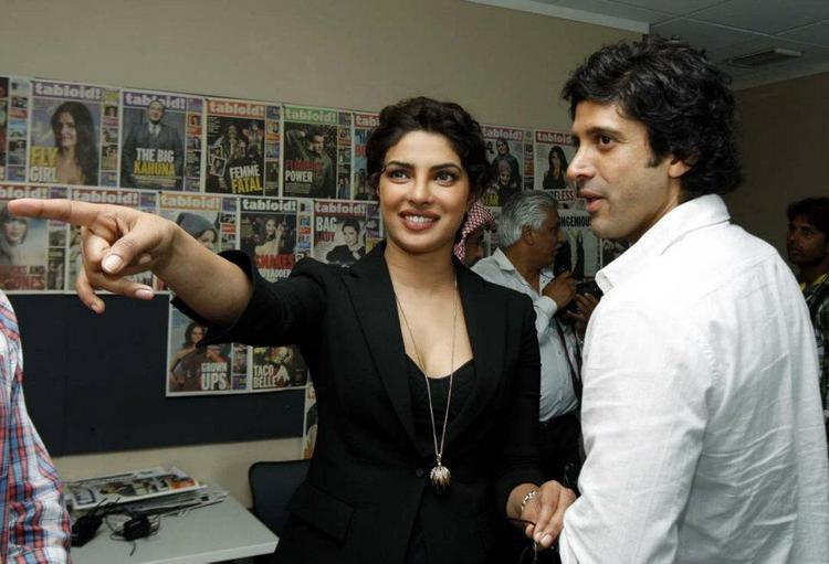 Priyanka and Farhan watching Tabloid Magazine covers