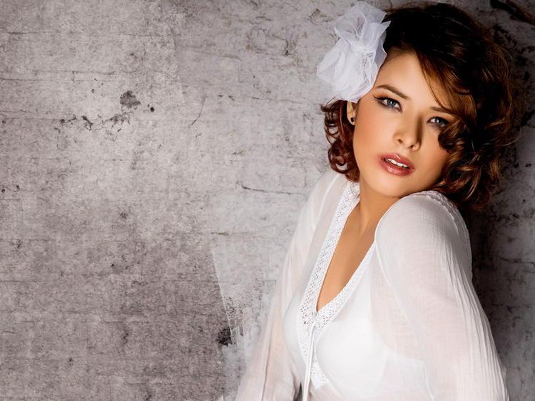 Udita Goswami hot pose in white dress