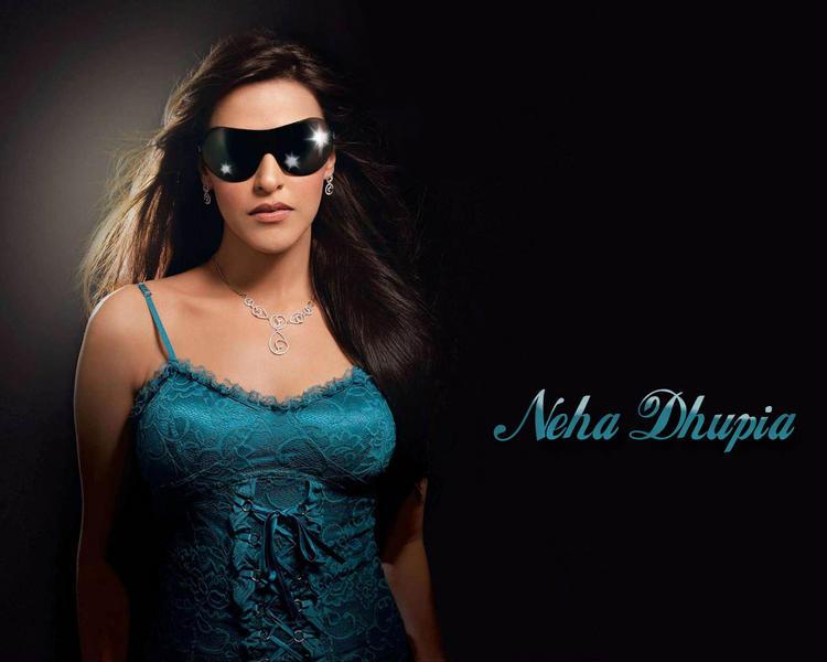Neha Dhupia hot pose wearing goggles