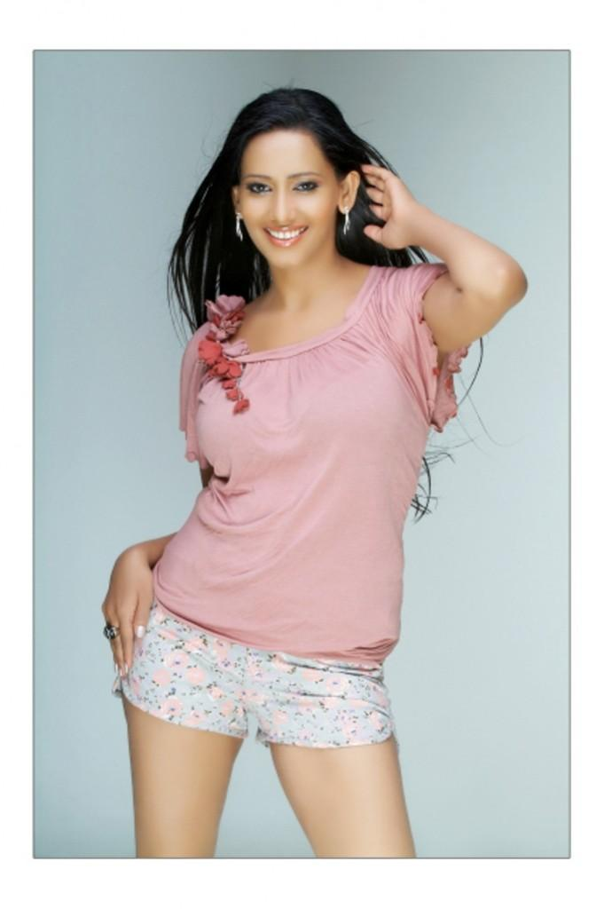 Sanjana singh sexy stills in pink color tops