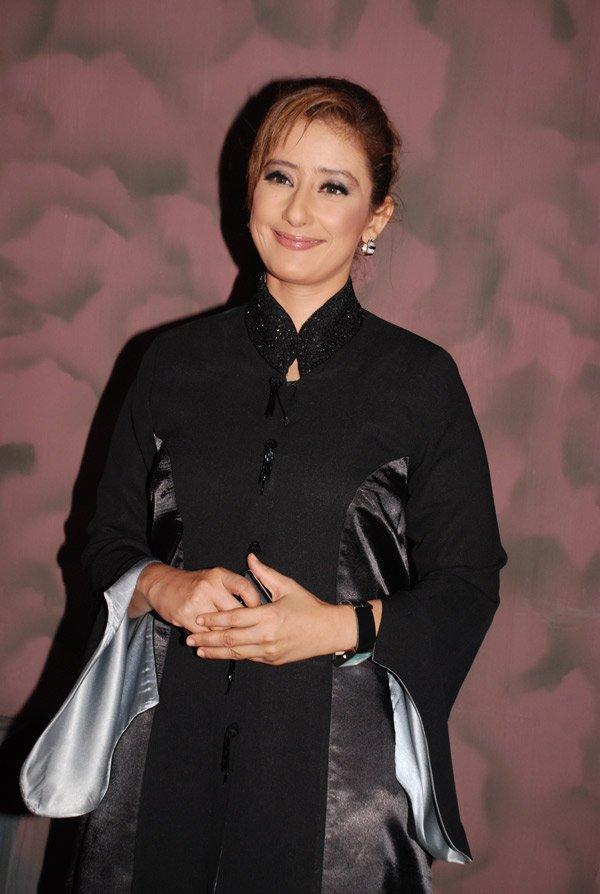 Manisha Koirala hot pose in black color dress