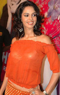 Mallika Sherawat Stylist Pic In Orange Color Dress