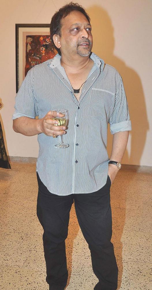 Pradeep Guha With Wide Glass at An Art Event