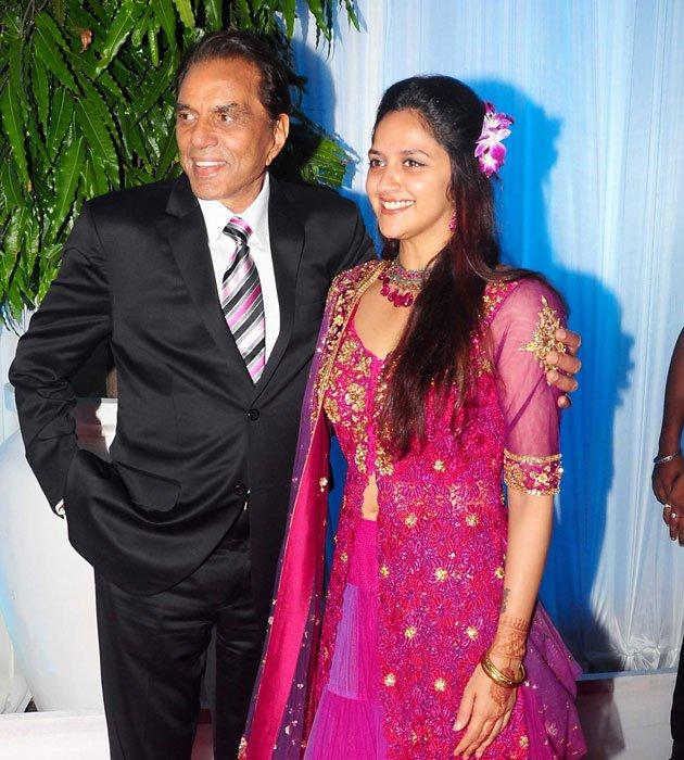 Ahana Poses With Dad Dharmendra at Esha's Grand Reception