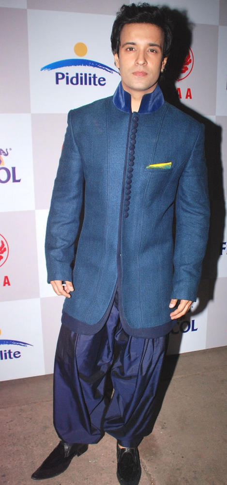 Aamir Ali Malik Snapped at CPAA Fashion Show 2012