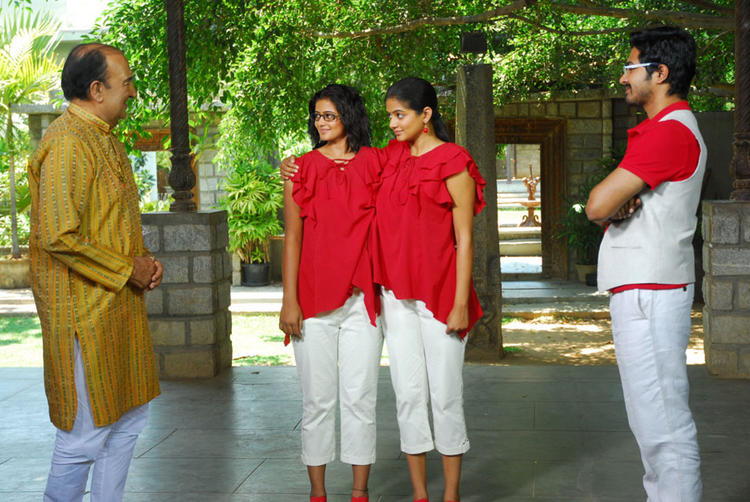 Priyamani as Conjoined Twin in Charulatha