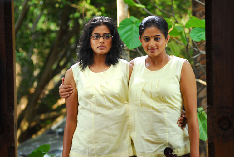 Priyamani Play Conjoining or Siamese Twins in Charulatha Movie
