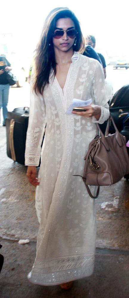Deepika Wears This Long White Dress Which Accentuates Her Slender Frame Perfectly