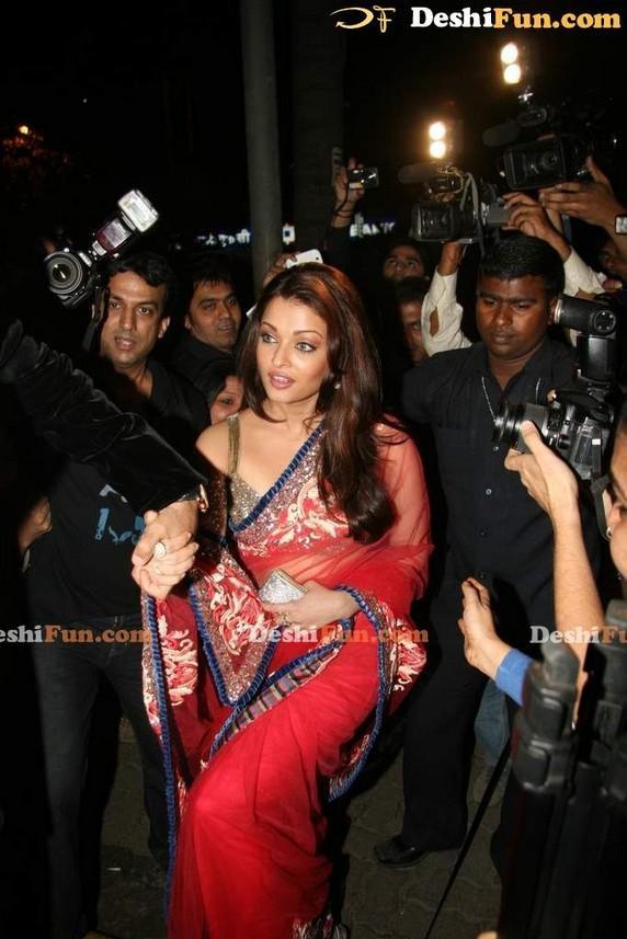 Aishwarya Rai Public Photo In Red Transparent Saree