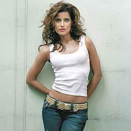 Nelly Furtado Pretty Still In White Tops and Blue Jeans