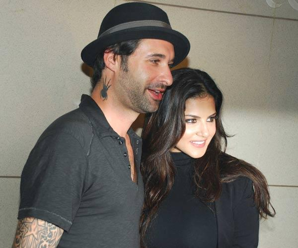 Sunny Leone With Hubby Daniel Poses at Airport