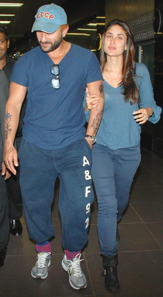 Saif Seems To Be Sporting Blonde Locks and New Tattoos at Mumbai Airport With Kareena
