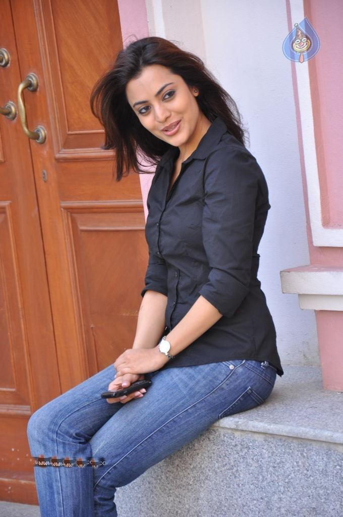 Nisha Agarwal in Black Shirt and Blue Jeans
