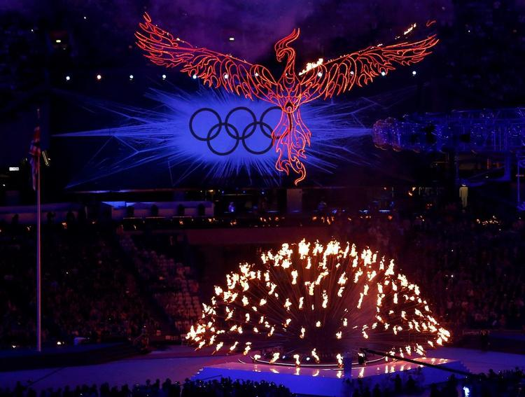 A Flaming Phoenix Flies Above The Olympic Flame as the Flame Extinguishes During the Closing Ceremony of the London Olympic Games 2012