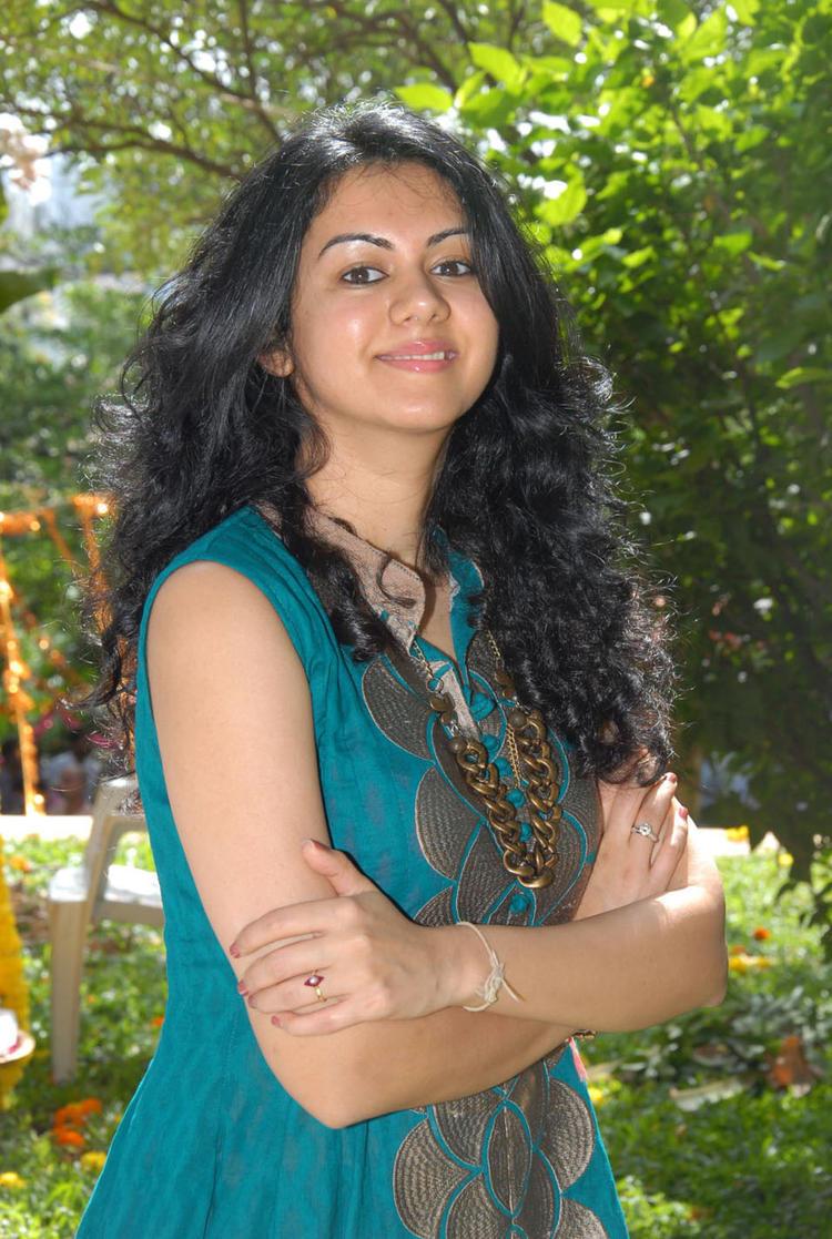 Kamna Jethmalani Sweet Smile Pic at Band Balu Movie Opening Event