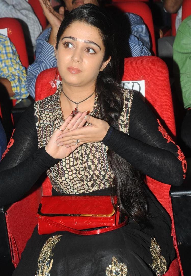 Charmi Kaur Cute Still in Black Dress At Damarukam Movie Audio Launch
