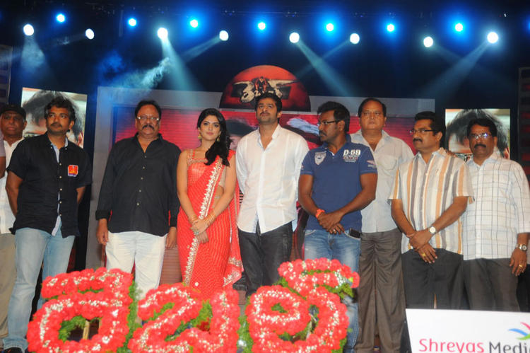 Cast and Crew Pose During Rebel Movie Audio Launch Event