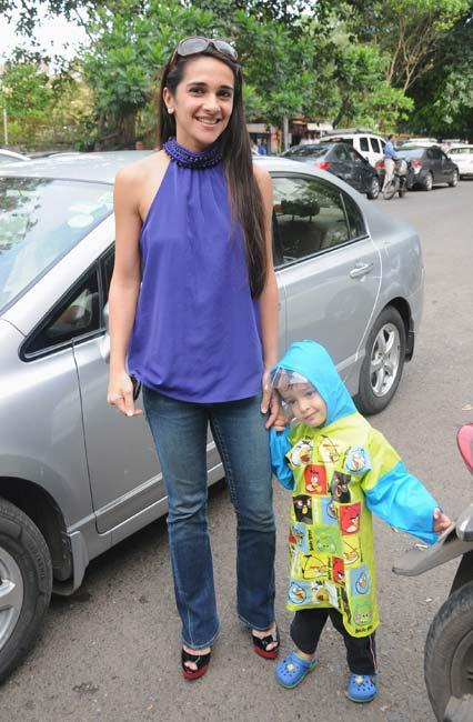 Tara Sharma With Son During The Launch Of Surily Goel's Collection