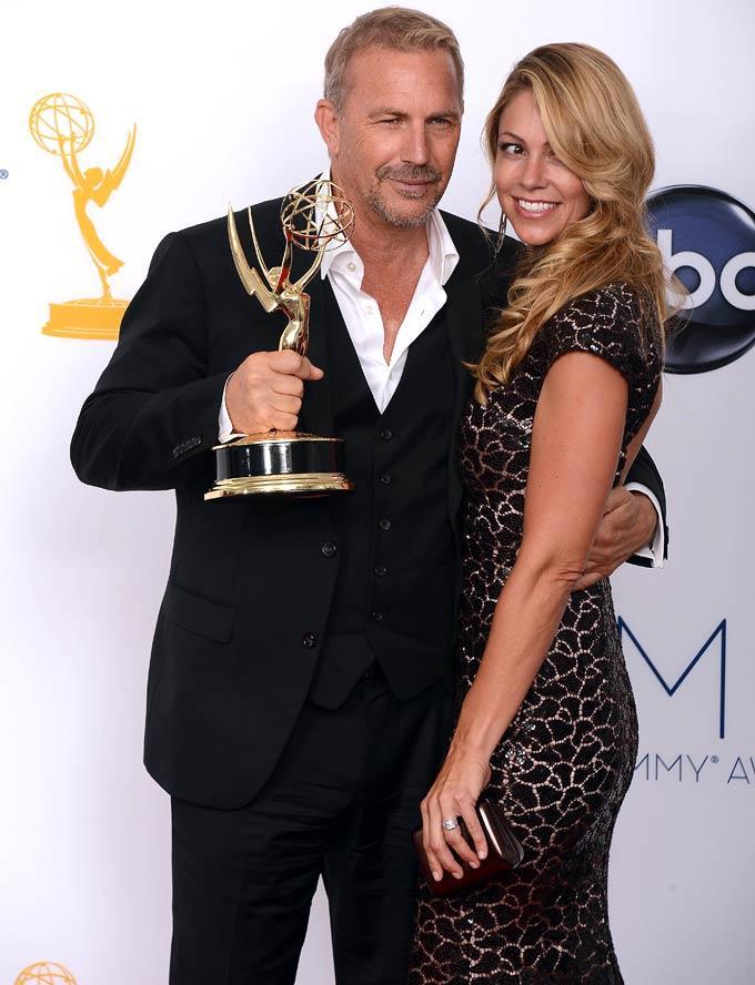 Actor Kevin Costner and Wife Christine Baumgartner Pose In The Press Room