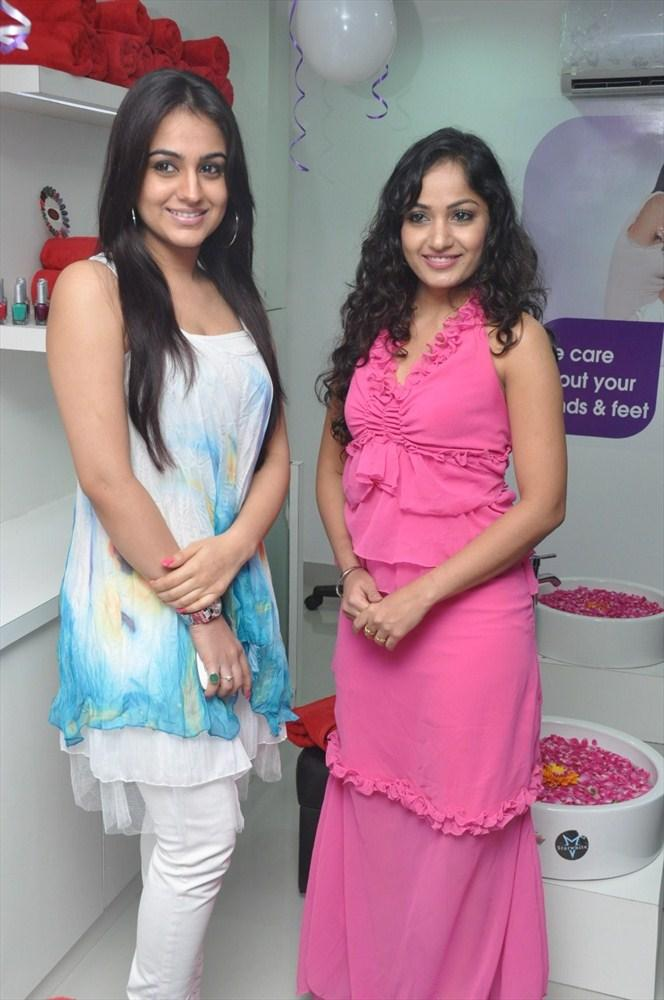Aksha and Madhavi Pose During The Launch Of Naturals Family Salon