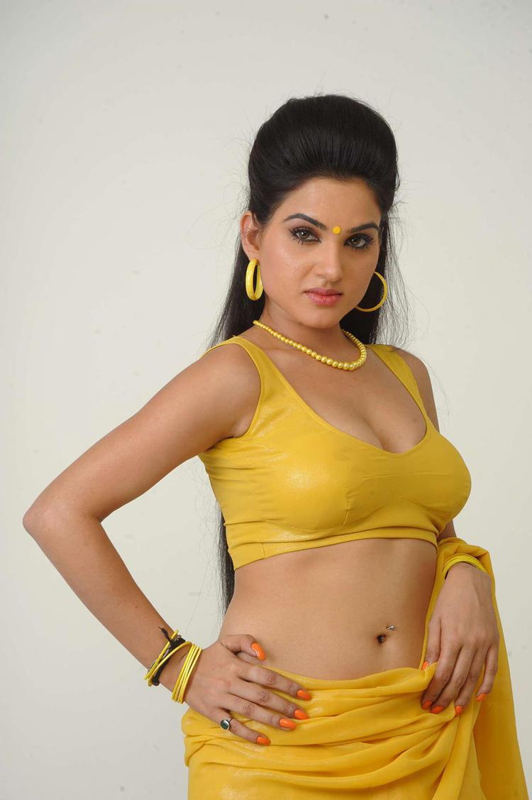 Kavya Expose Her Sexy Navel In Yellow Saree Still
